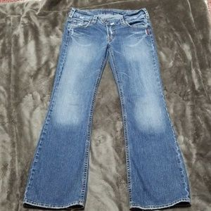 SILVER JEANS TUESDAY DISTRESSED BOOT CUT JEANS